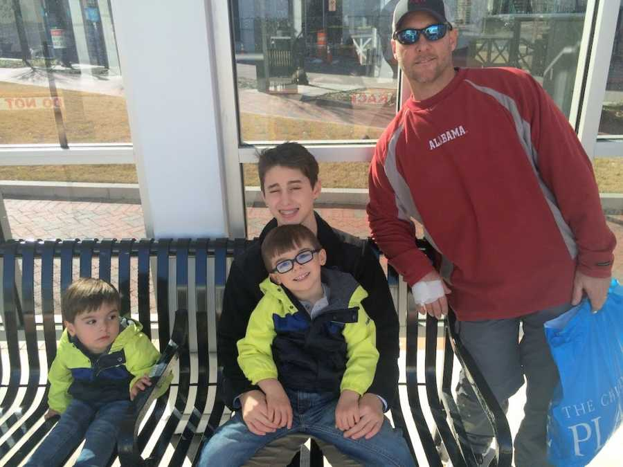 dad and 3 sons on a bench