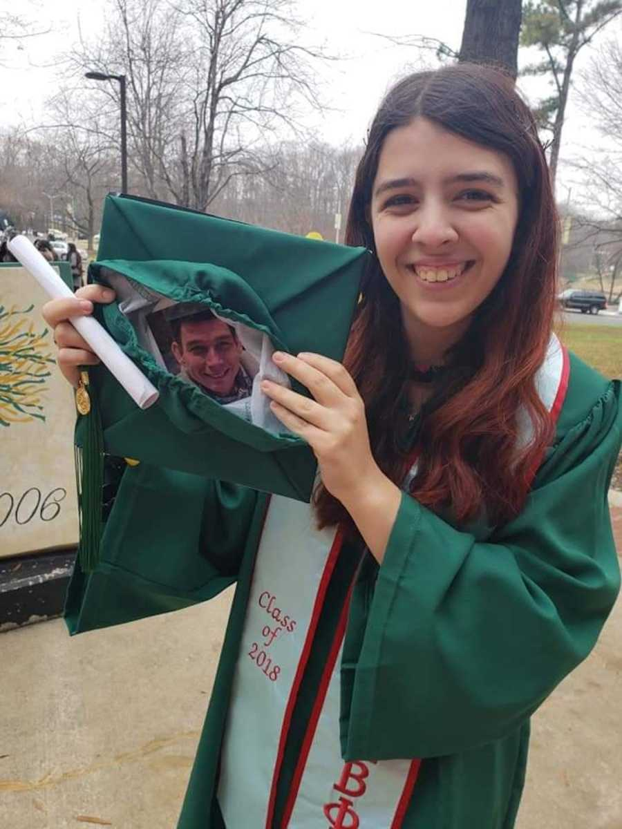 girl holding picture of dad in graduation cap