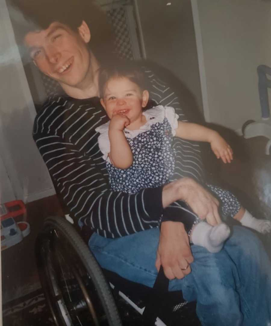 man with cerebral palsy holding daughter