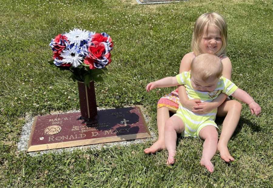 photo of two kids by grandpa's grave