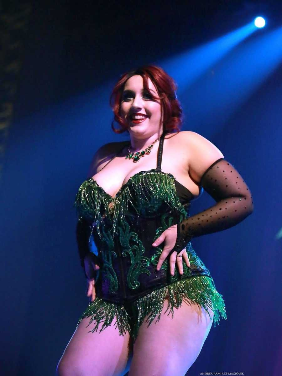 woman in black and green corset top at burlesque show