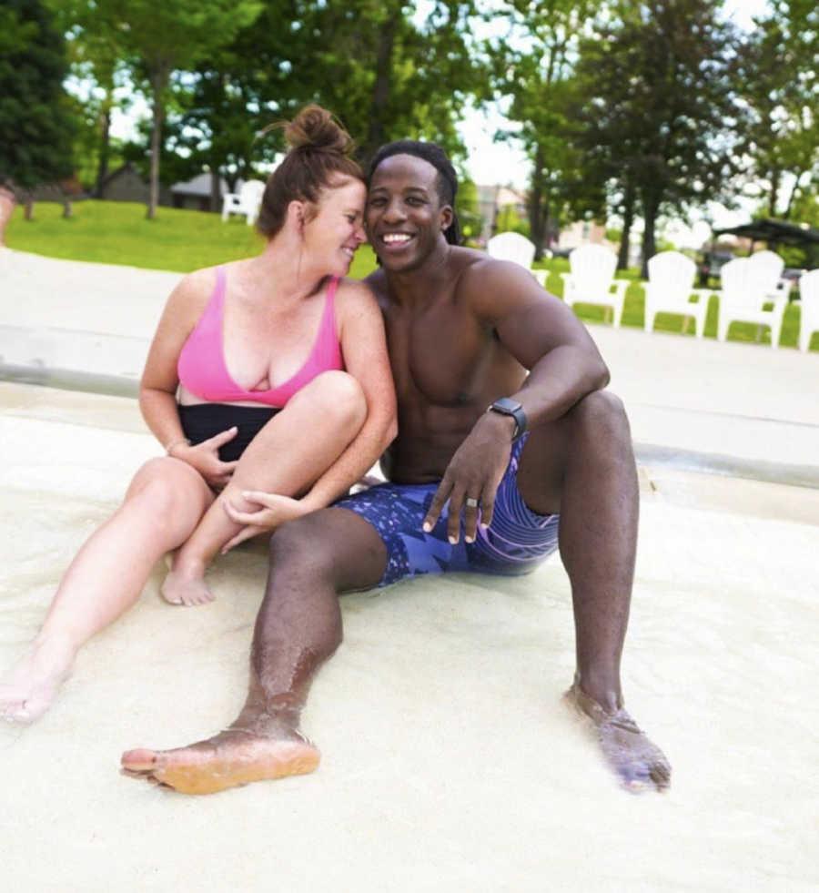 Mixed race couple, pregnant woman
