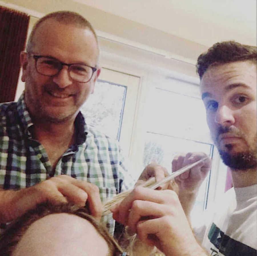 two men shaving a girl's head