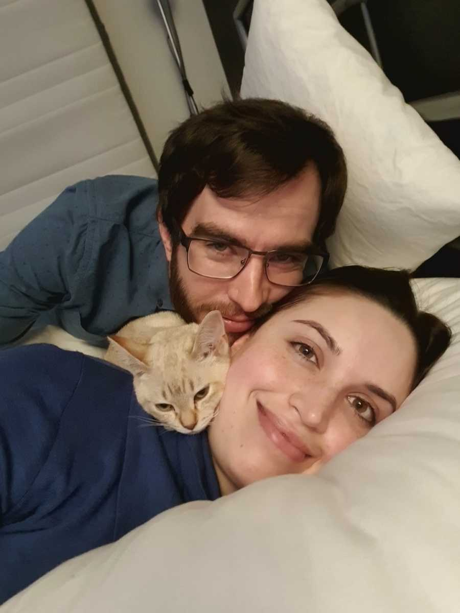 woman with her fiance and cat