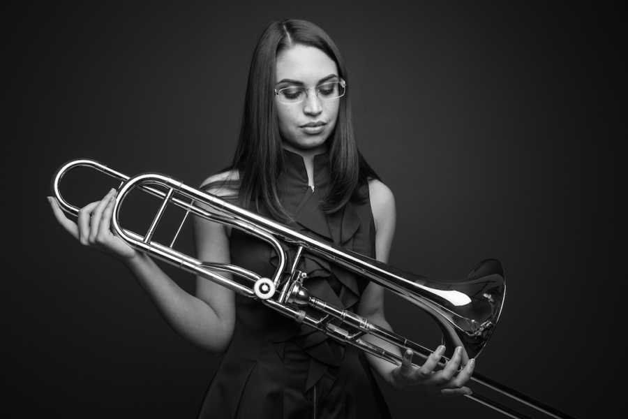 woman holding a trombone