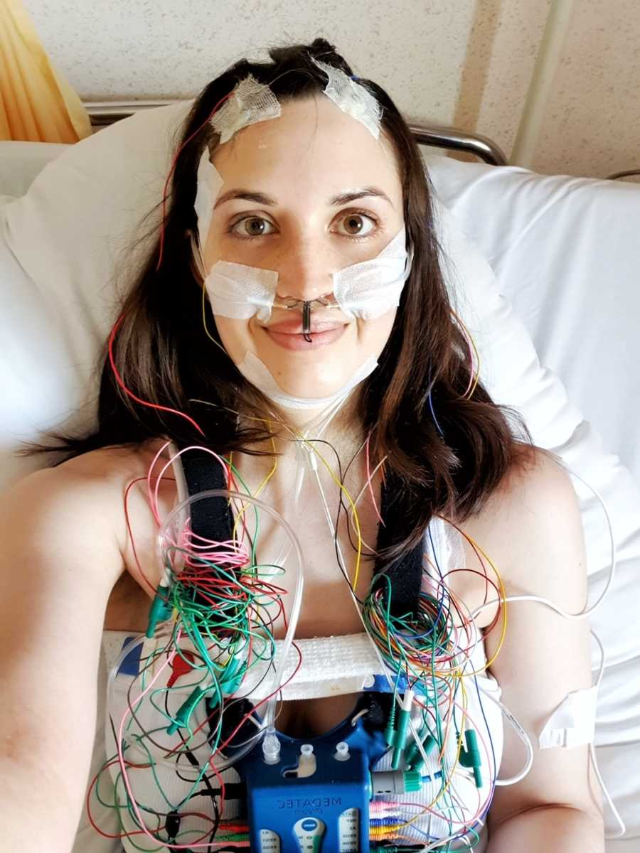 woman in hospital connected to wires
