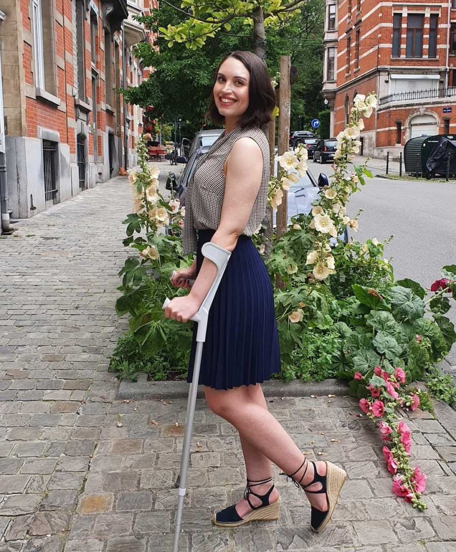 woman with arm crutches