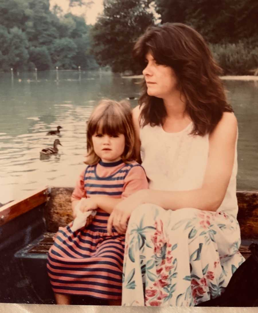 mom and young daughter in a boat