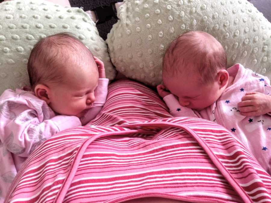 Mom of three snaps photo of twin daughters as they sleep after feeding