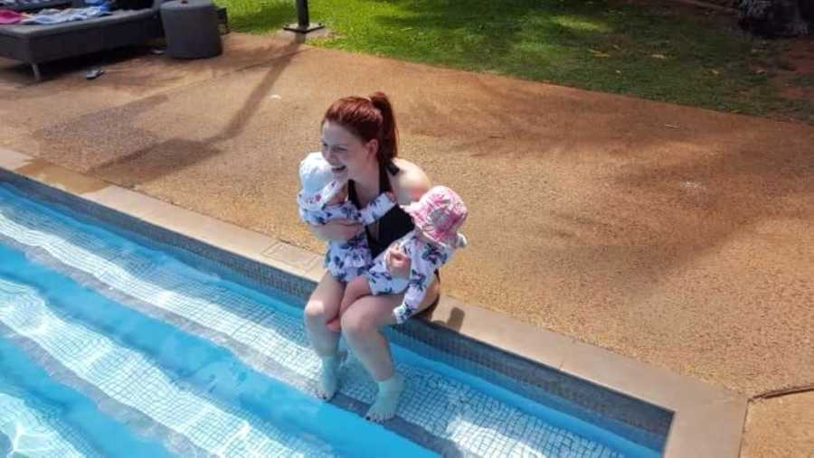 Girl mom of three enjoys a day at the pool with her twins