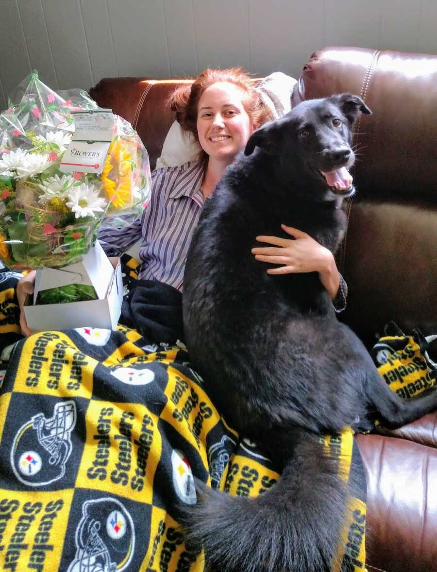 woman recovering from surgery with her dog