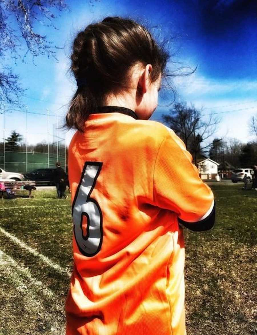 young girl in soccer field