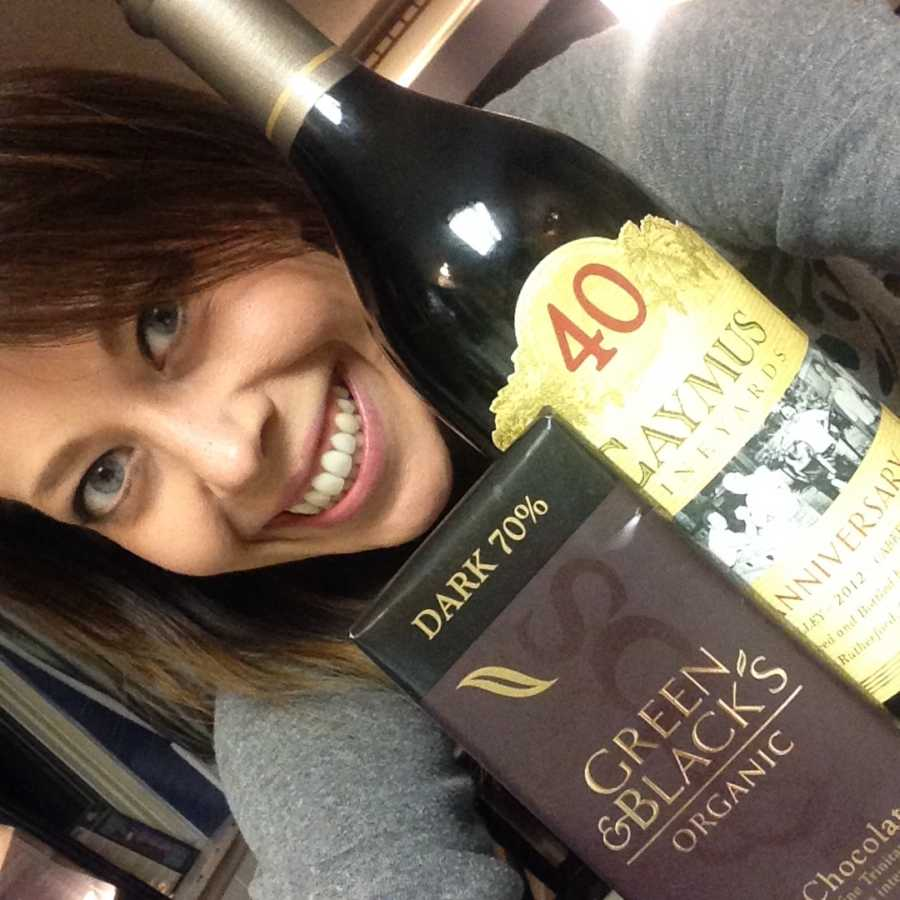 woman posing with a wine bottle