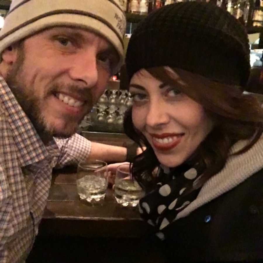 couple drinking and smiling
