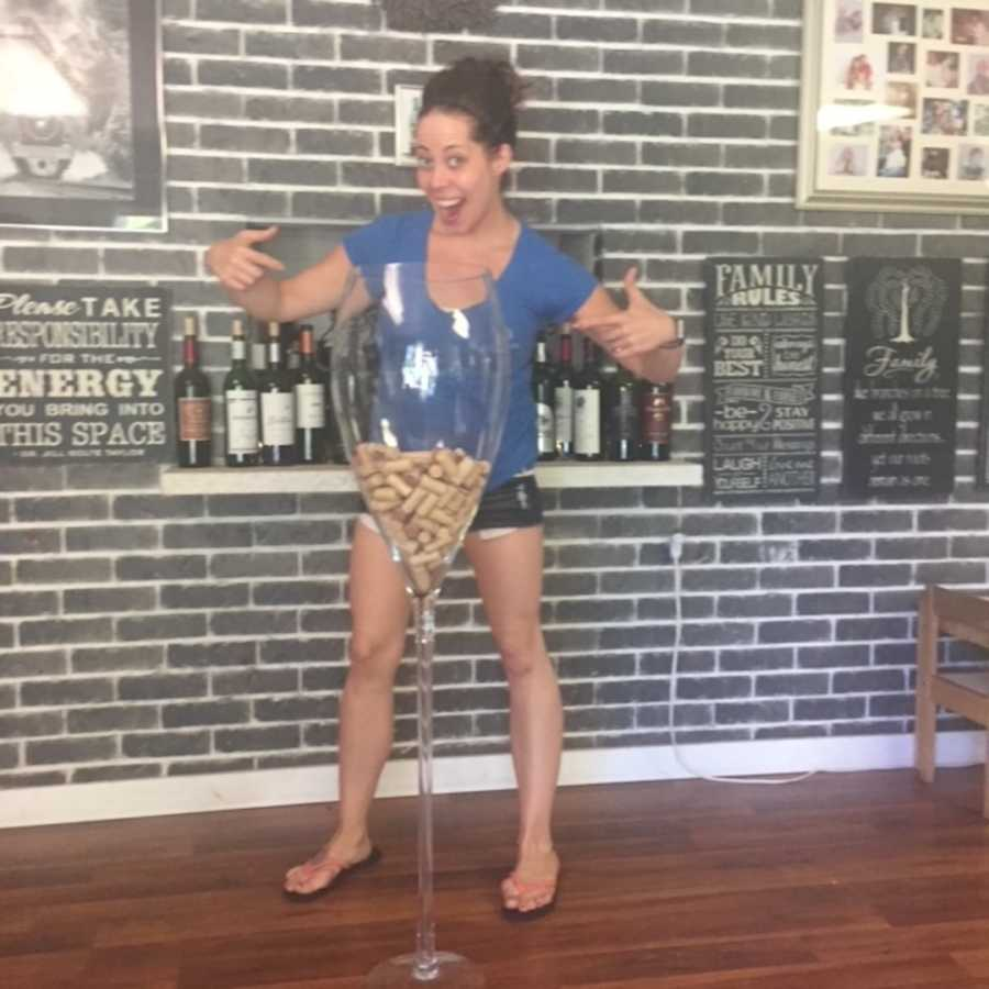 woman standing with gigantic wine glass