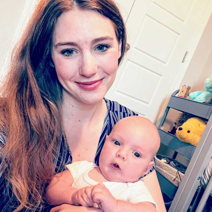 Stay at home mom takes selfie with her newborn son