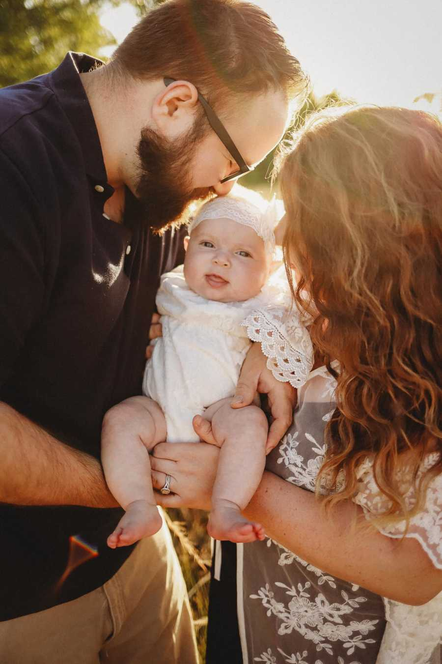 Couple give love to their newborn daughter