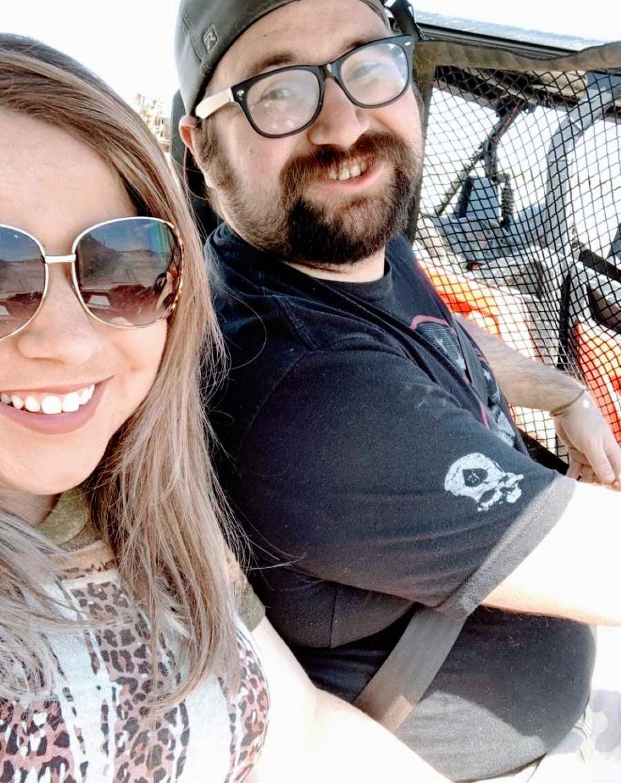 Couple take a selfie together while going on a Jeep ride