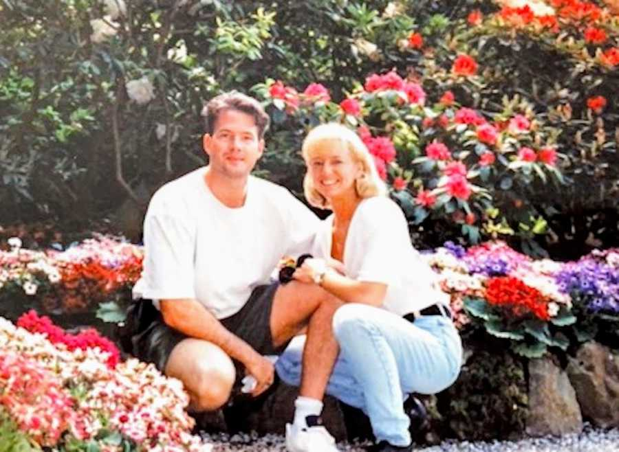 couple surrounded by flowers