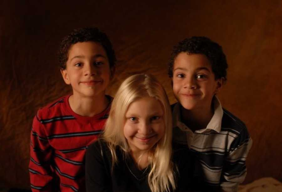 3 siblings smiling