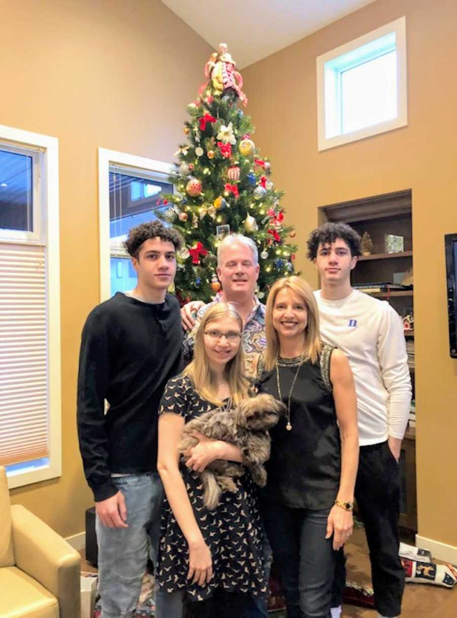 family portrait in front of Christmas tree