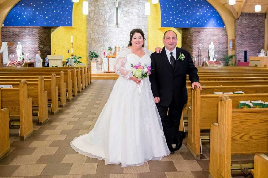 Couple who met on Facebook take a photo together in the church where they had their wedding ceremony