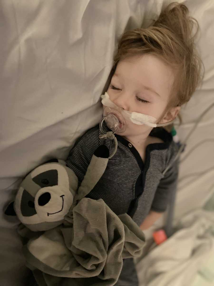 young boy with breathing tube