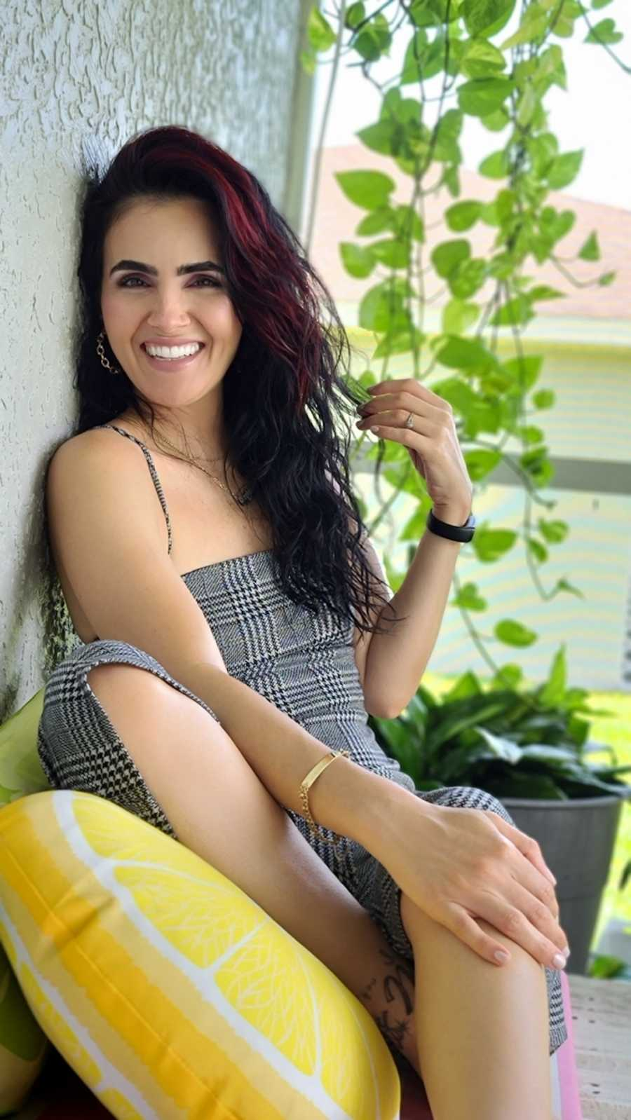 woman in plaid dress smiling