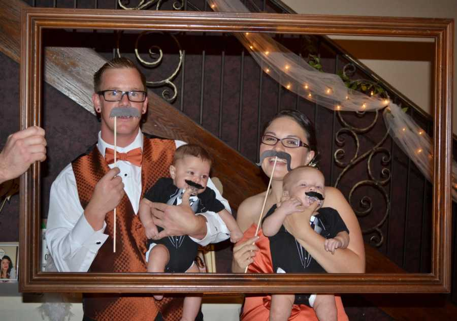 photo of couple and their kids in picture frame