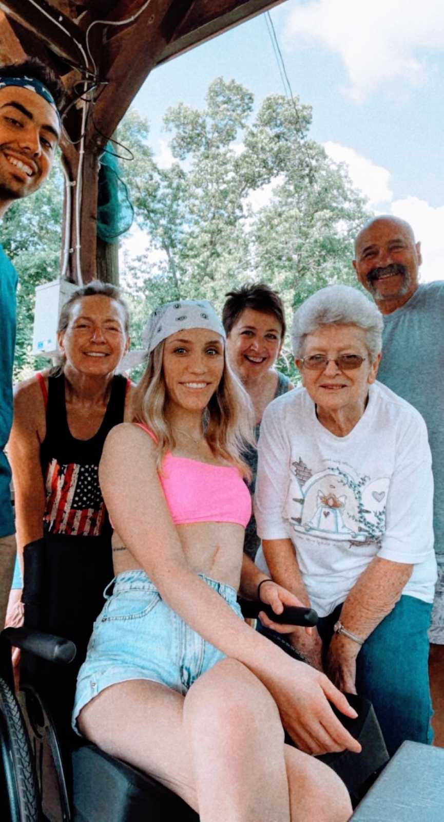 Woman wheelchair bound after tragic car accident takes a photo with her family