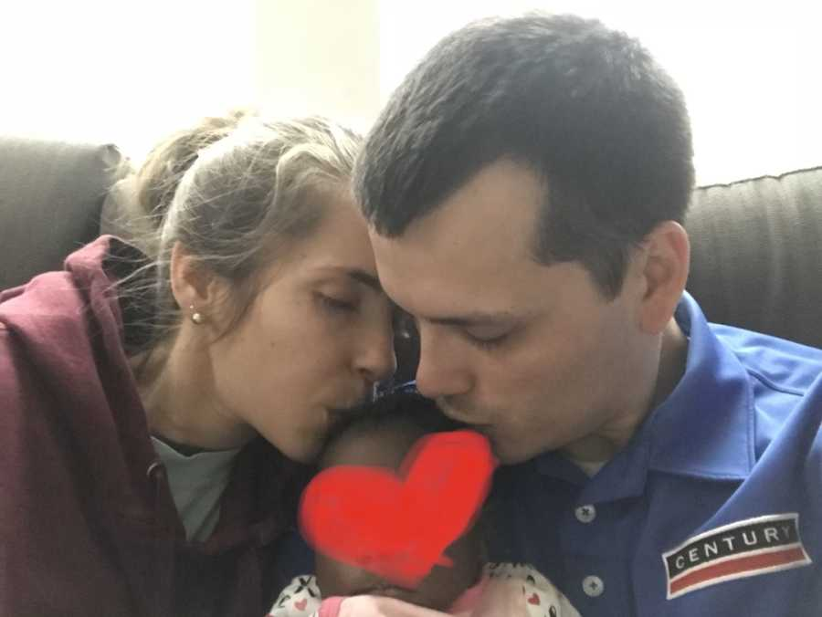 couple with their foster baby