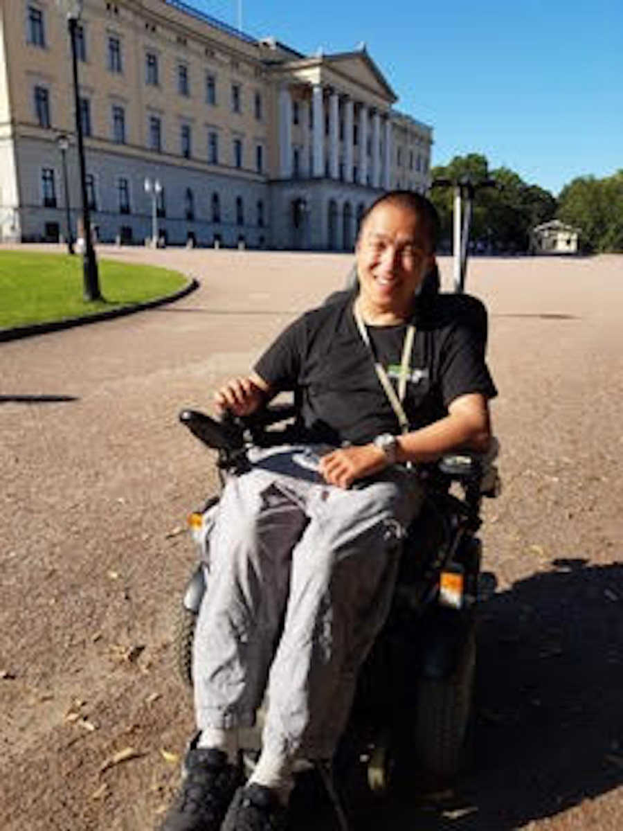 young man in wheelchair smiling