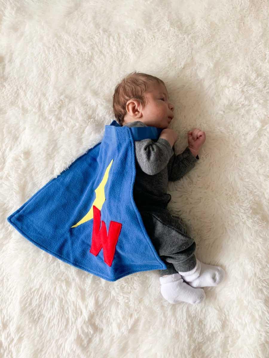 A little boy dressed like a superhero