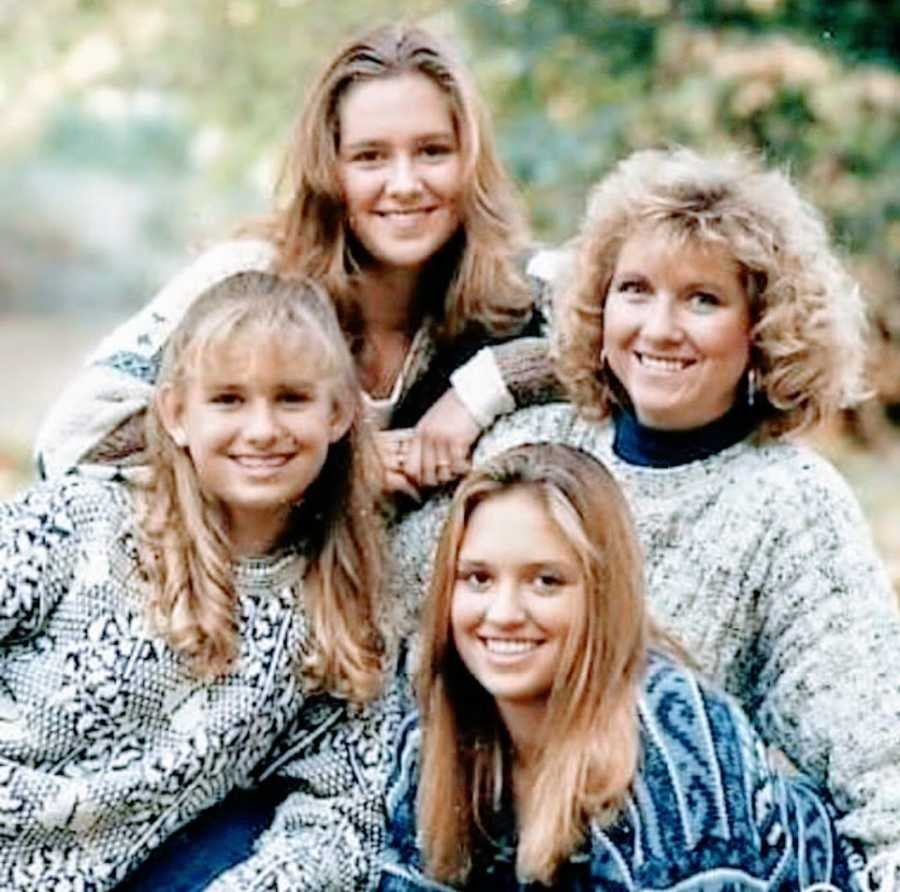 A mother sits with her three daughters