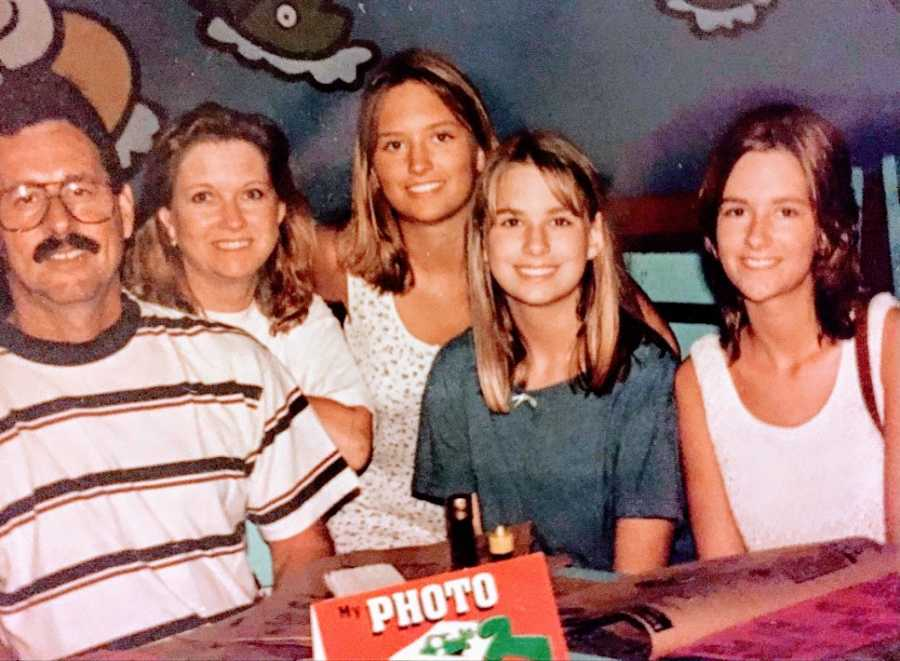 Parents with their three daughters