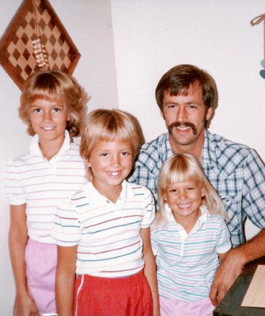 A father and his three young daughters