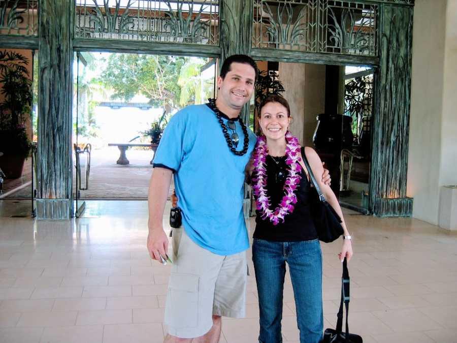 A couple wearing leis on their honeymoon