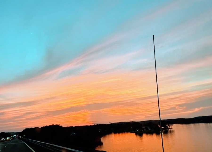 A sunset with orange fading into blue