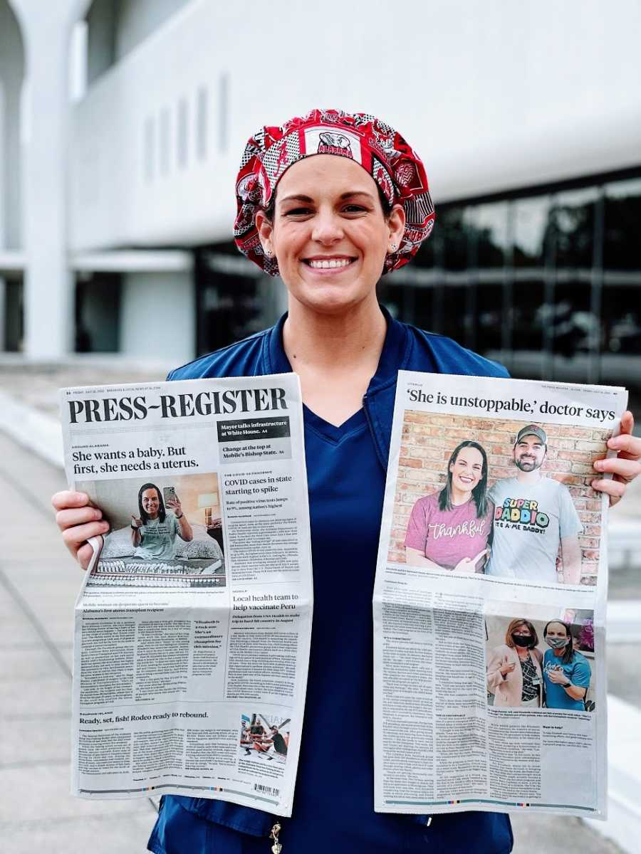 A woman holds up two newspapers featuring her story