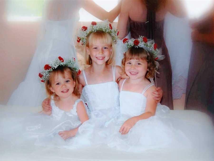 Three little girls wearing dresses for a wedding
