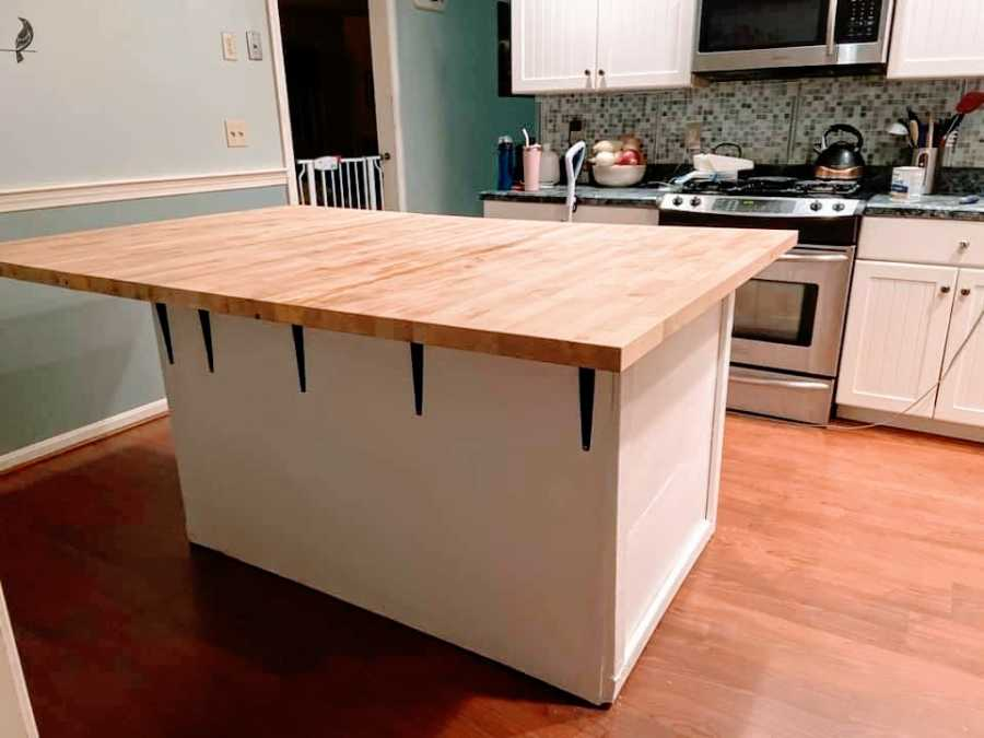 An empty kitchen with a large butcherblock island