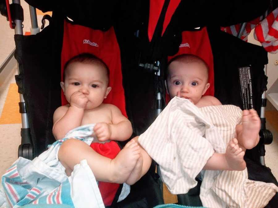 Twin boys sitting in a stroller