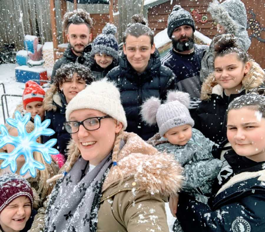 A family of 13 outside in the snow