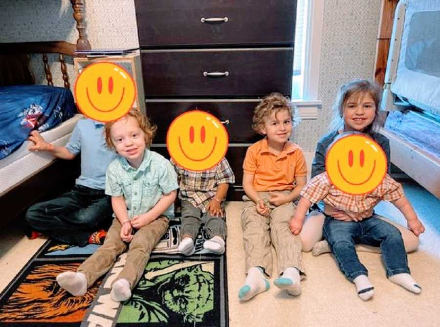 Children sit in their room with their foster siblings