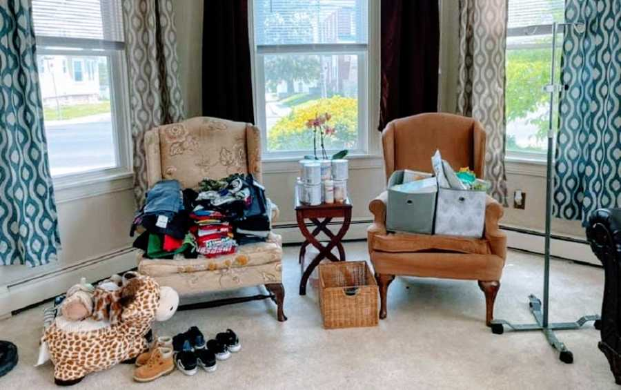 Clothes and toys sitting on chairs for a foster reunification