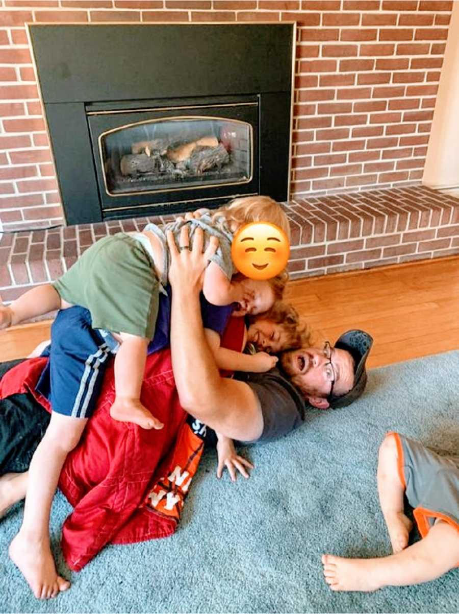 A foster dad plays with three of his children