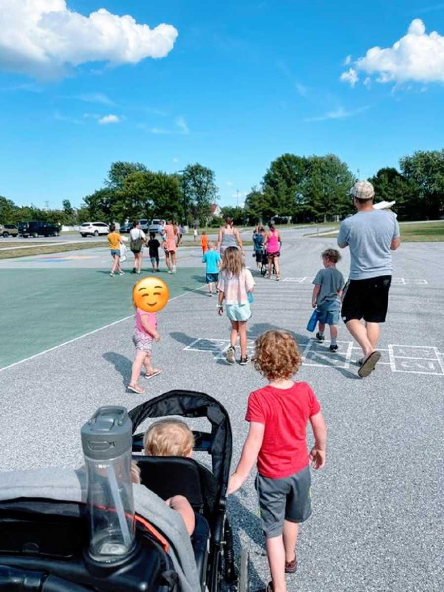 Foster parents walk with their biological and foster children