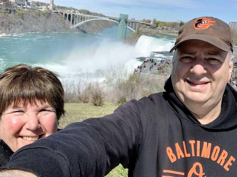 A husband and wife together at Niagara Falls