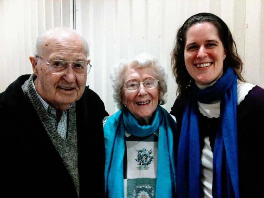 A woman stands with her grandparents