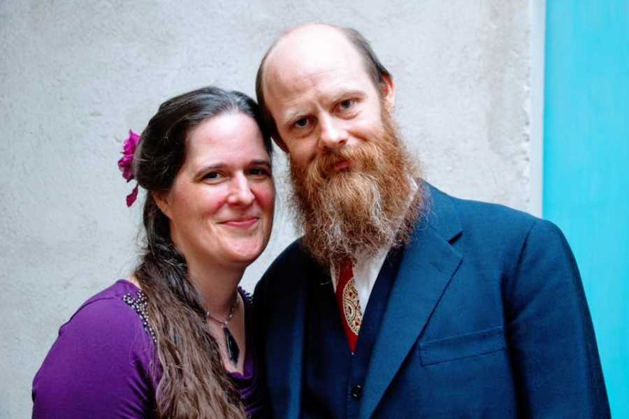 A woman and her husband wearing dressy clothes